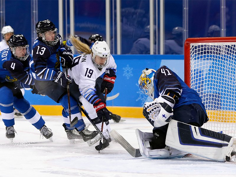 Gigi Marvin (19), of the United States, tries to shoot against goalie Noora Raty (41), of Finland, during the second period of the preliminary round of the women's hockey game at the 2018 Winter Olympics in Gangneung, South Korea, on Feb. 11, 2018. (AP Photo/Frank Franklin II; caption amended by RNS)
