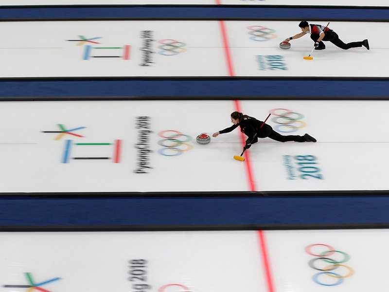 Russian curler Anastasia Bryzgalova, center, and South Korea's Lee Kijeong, top right, practice during the curling mixed doubles training session ahead of the 2018 Winter Olympics in Gangneung, South Korea, Wednesday, Feb. 7, 2018. (AP Photo/Aaron Favila)