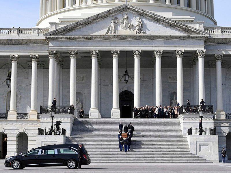 The casket of Rev. Billy Graham is carried up the steps of the U.S. Capitol in Washington, Feb. 28, 2018, where it will lie in honor in the Rotunda. It's a rare honor for a private citizen to lie in honor at the Capitol. Graham died Wednesday in his sleep at his North Carolina home. He was 99. (AP Photo/Susan Walsh, Pool)