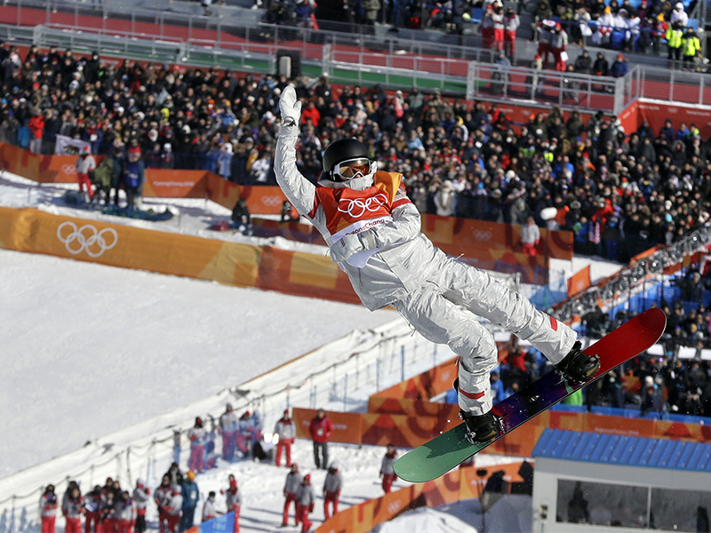 Kelly Clark, of the United States, jumps during the women's halfpipe finals at Phoenix Snow Park at the 2018 Winter Olympics in Pyeongchang, South Korea, on Feb. 13, 2018. (AP Photo/Kin Cheung; caption amended by RNS)