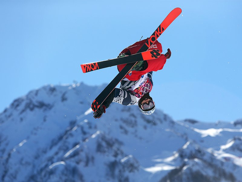 Nick Goepper makes a jump during a run in the men's ski slopestyle final to win the bronze medal at the Rosa Khutor Extreme Park, at the 2014 Winter Olympics, on Feb. 13, 2014, in Krasnaya Polyana, Russia. (AP Photo/Sergei Grits)