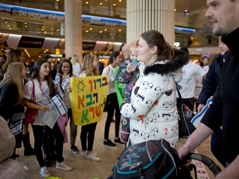 In this Tuesday, Jan. 30, 2018 photo, New Jewish immigrants from the Ukraine arrive at the Ben Gurion airport near Tel Aviv, Israel,. What was once a strictly Jewish-funded mission to bring Jews to Israel is increasingly being bankrolled by evangelical Christians. Israel's Christian allies now fund a third of all immigrants moving to the country, according to a tally by the Associated Press. (AP Photo/Ariel Schalit)