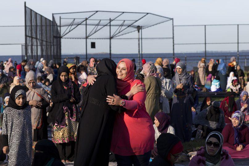 Muslim women greet one another as they arrive for Eid al-Adha prayers on Sept. 1, 2017, in Bensonhurst Park in the Brooklyn borough of New York. (AP Photo/Mark Lennihan)