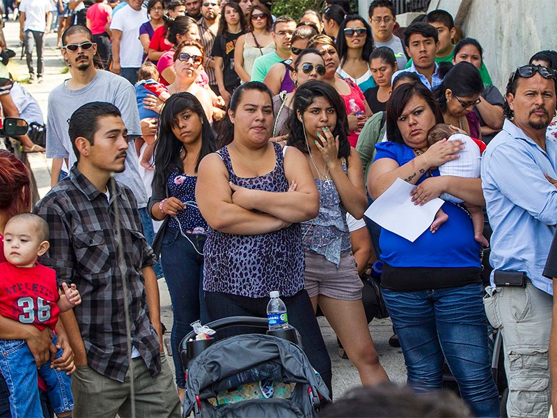 A line of people living in the U.S. without legal permission wait outside the Coalition for Humane Immigrant Rights in Los Angeles in this Aug. 15, 2012, file photo. California is suing the Trump administration over its decision to add a question about citizenship to the 2020 U.S. Census. In announcing the lawsuit on March 27, 2018, California Attorney General Xavier Becerra says adding such a question is a reckless decision that would violate the U.S. Constitution and cause a population undercount. (AP Photo/Damian Dovarganes)