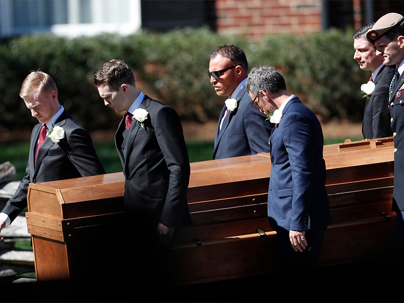 The casket of evangelist Billy Graham is moved during a funeral service at the Billy Graham Library on March 2, 2018, in Charlotte, N.C. (AP Photo/John Bazemore)