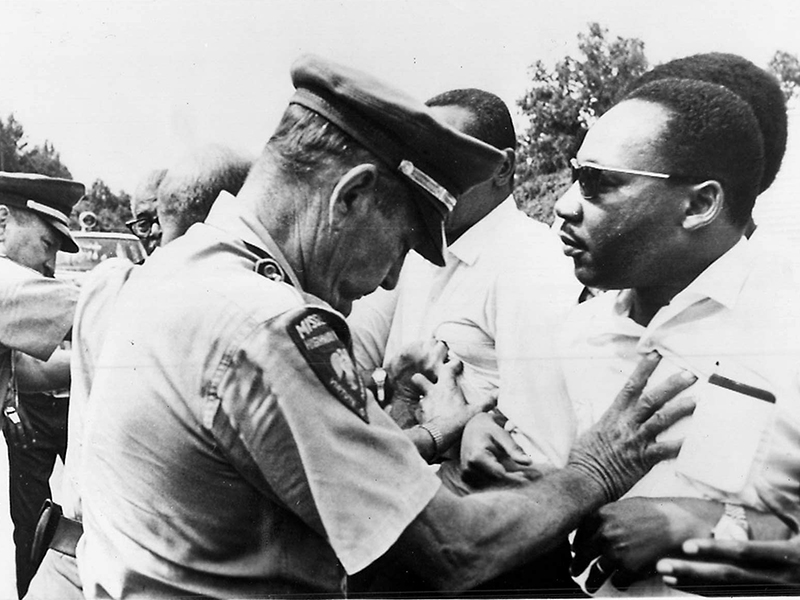 Dr. Martin Luther King Jr., right, and other civil rights leaders, are pushed off the road as they resume a voters' march begun by James Meredith. Later they continued their walk, marching single file along the highway's shoulder. Meredith was shot from ambush by a white man as he was marching from Memphis, Tenn., to Jackson, capital of Mississippi, in an effort to encourage black residents to vote in the state's primary election. Religious leaders were quick to condemn the shooting and called for greater efforts in behalf of voting rights. Religion News Service file photo