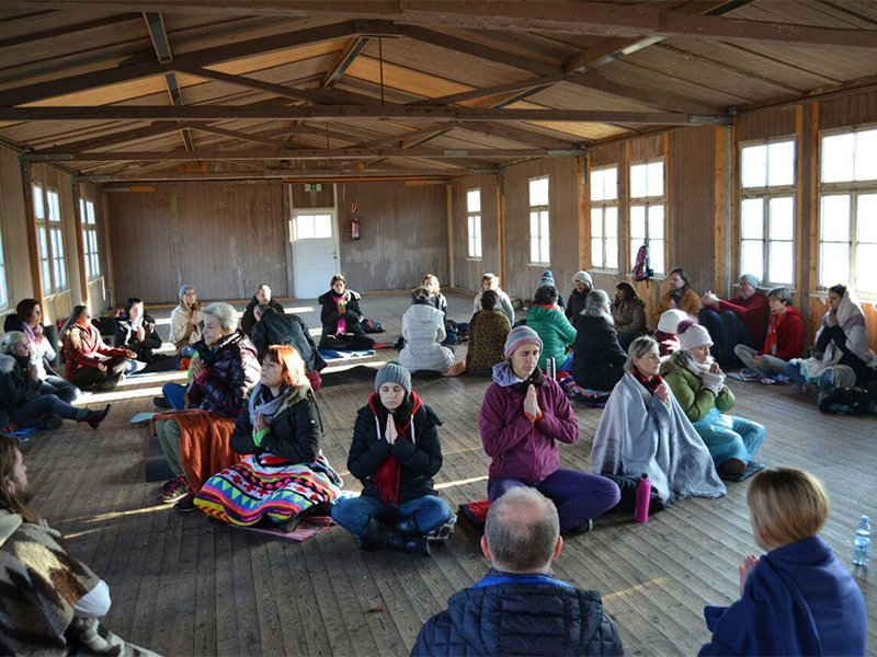 People participate in a Bhakti Marga om chanting at the Mauthausen concentration campnational memorial site in Austria on Dec. 10, 2017.  Photo courtesy of Bhakti Marga