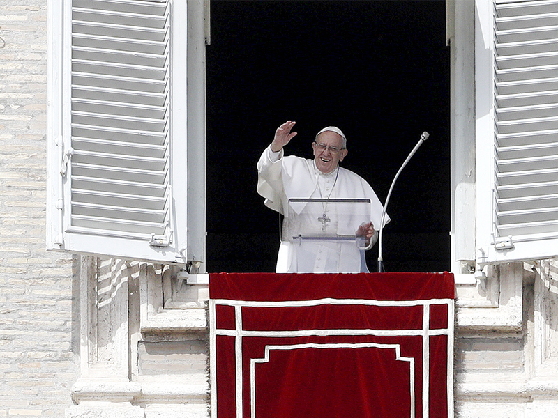 Pope Francis waves to faithful during the Angelus noon prayer in St. Peter's Square at the Vatican on March 11, 2018. (AP Photo/Gregorio Borgia)