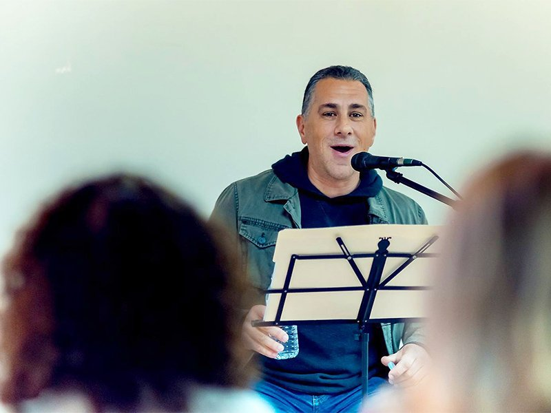 "John Pavolitz speaks during ""A Bigger Table"" tour event in Philadelphia in February.  Photo by Dana Stinson"