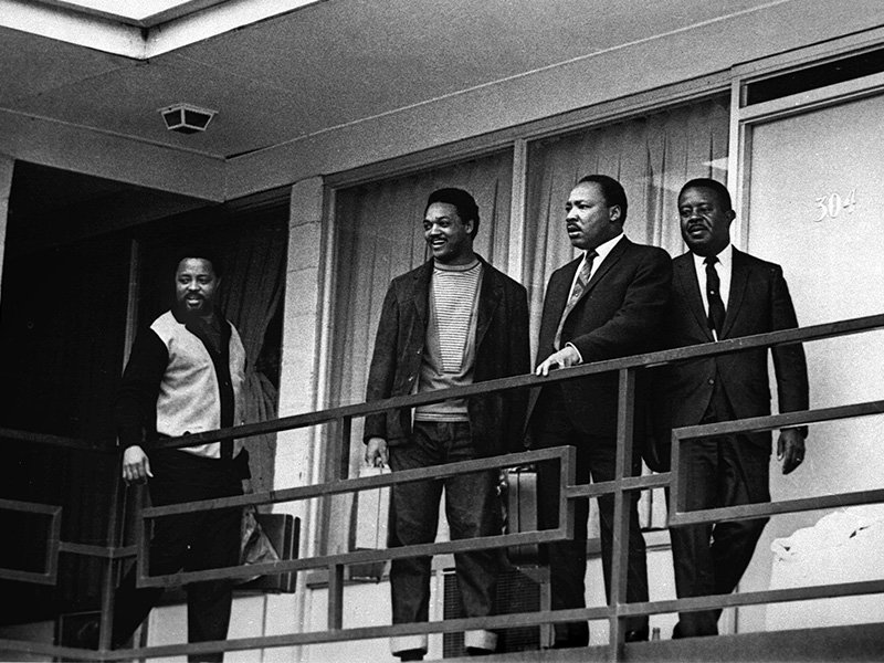 The Rev. Martin Luther King Jr. stands with other civil rights leaders on the balcony of the Lorraine Motel in Memphis, Tennessee, on April 3, 1968, a day before he was assassinated at approximately the same place. From left are Hosea Williams, Jesse Jackson, King and Ralph Abernathy. The 39-year-old Nobel laureate was the proponent of nonviolence in the American civil rights movement of the 1960s. (AP Photo/Charles Kelly)