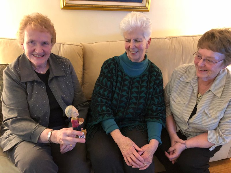 Sister Peggy Geraghty, from left, Sister Mary Fran McLaughlin, and Sister Diane O'Donnell with a bobble head of their friend Sister Jean, the team Chaplain for Loyola-Chicago as they watch the Sweet 16 game on March 22, 2018. Photo by Maggie Hendricks/USA TODAY Sports