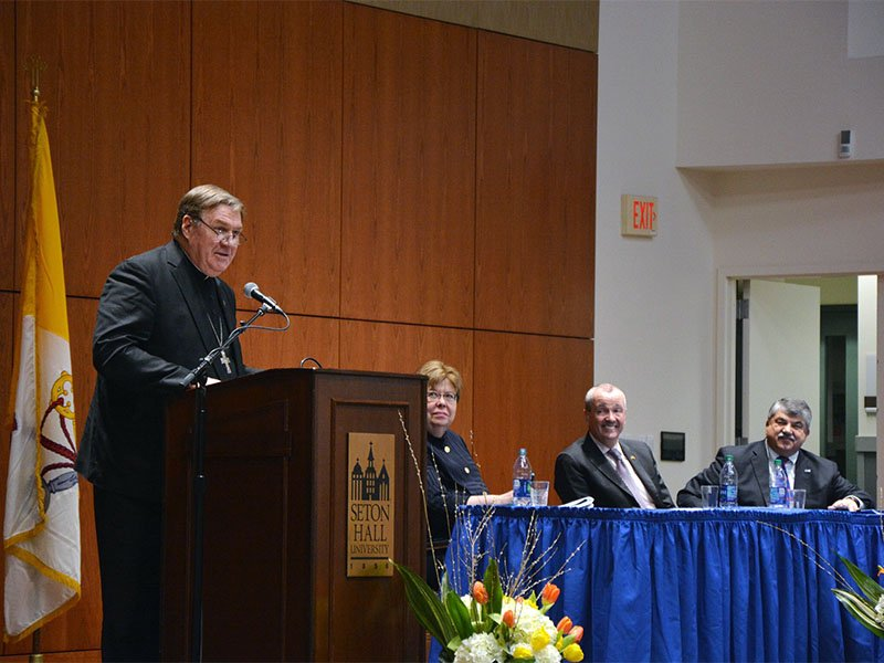 Newark Cardinal Joseph Tobin, left, speaks during a labor and faith forum at Seton Hall University on March 6, 2018, in South Orange, N.J. Tobin was joined by AFL-CIO President Richard Trumka, far right, and explained the church's support for unions. RNS photo by Jack Jenkins