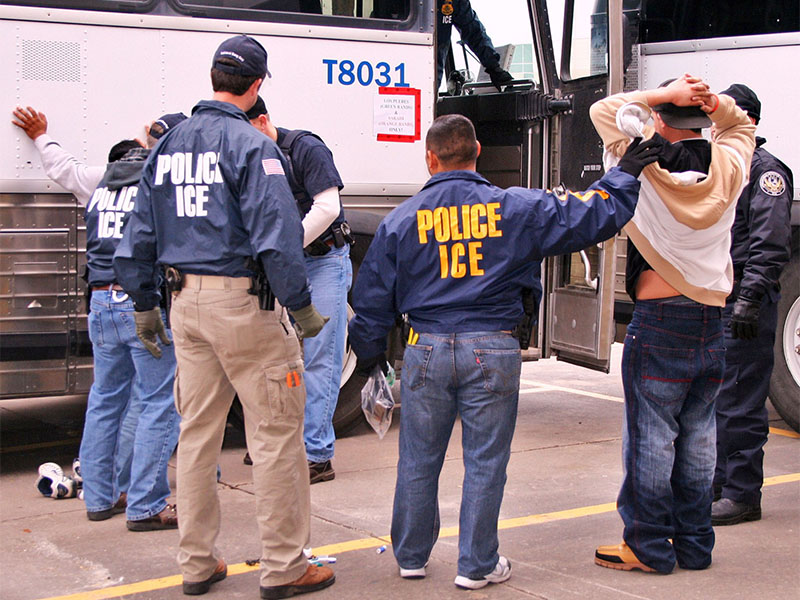 U.S. Immigration and Customs Enforcement officers arrest individuals during a raid on Feb. 2, 2010. Photo courtesy of ICE