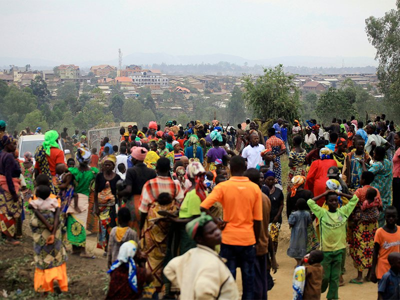 People who fled from their homes after recent ethnic violence take refuge at a camp for displaced people in Bunia, eastern Congo, on Feb. 17, 2018. Ethnic violence in Congo's northeast has forced more than 32,000 to flee to Bunia, where humanitarian assistance is strained and the suffering are eager for improved conditions. (AP Photo/Al-Hadji Kudra Maliro)
