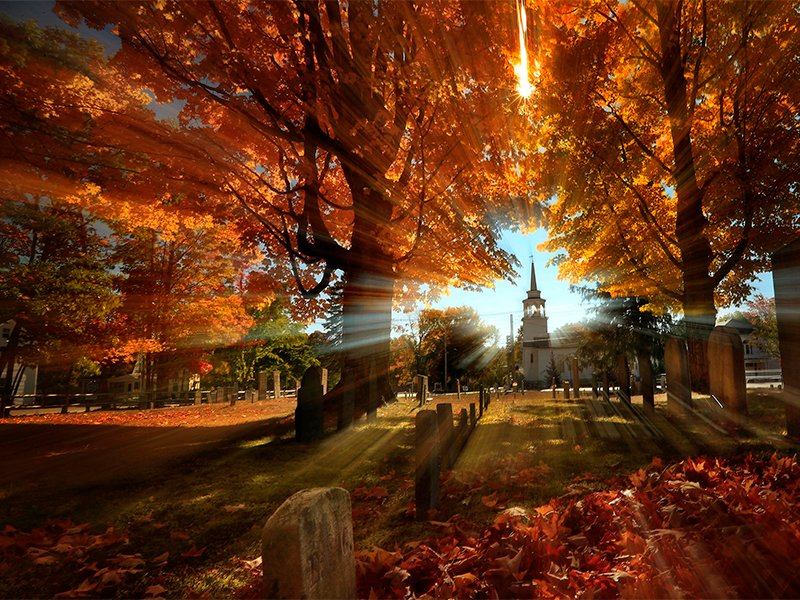 Autumn's colors peak on hardwood trees in a cemetery near the Congregational Church in Cumberland, Maine, on Oct. 10, 2016, on a photo taken with a slow shutter speed. The history of the Congregational Church is the history of Colonial New England. Their records from 1630 to 1800 are being put online by the Boston-based Congregational Library and Archives Hidden Histories project, with a boost of a than $300,000 from a grant from the National Endowment for the Humanities. (AP Photo/Robert F. Bukaty)
