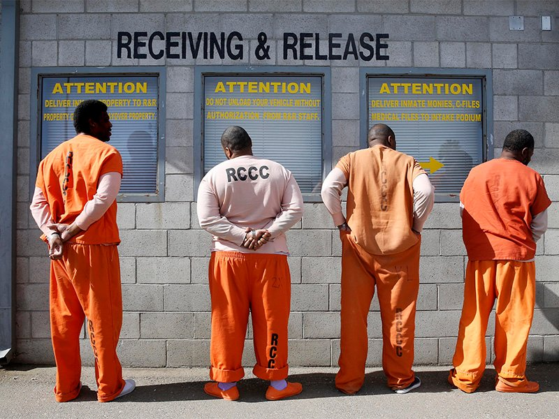 Prisoners from Sacramento County await processing after arriving at the Deuel Vocational Institution in Tracy, California, on Feb. 20, 2014. (AP Photo/Rich Pedroncelli)