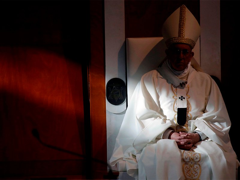 Pope Francis sits as he celebrates Mass in the parish church of San Paolo della Croce, in the Corviale neighborhood of Rome, on April 15, 2018. (AP Photo/Alessandra Tarantino)