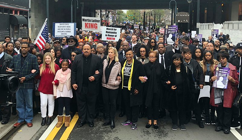 Martin Luther King III, fourth from left, leads the March for Humanity on April 9, 2018, in Atlanta. The march commemorates the funeral procession of the Rev. Martin Luther King Jr. 50 years ago. To the right of King is Kerry Kennedy, daughter of Robert Kennedy, and Bernice King, daughter of Martin Luther King Jr. To the left is his daughter Yolanda Renee King and Jaclyn Corin, an organizer of March for Our Lives. Behind King is the Rev. Al Sharpton. Three years later, a panel was held including Martin Luther King III discussing voting legislation. (AP Photo/Jonathan Landrum)