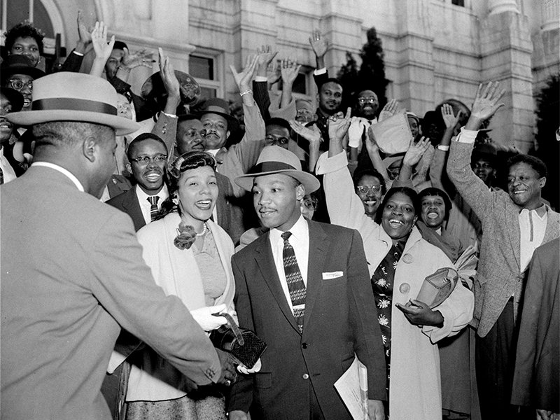 The Rev. Ralph Abernathy, left, shakes hands with the Rev. Martin Luther King Jr. in Montgomery, Ala., on March 22, 1956, as supporters cheer for King, who had just been found guilty of leading the Montgomery bus boycott.  Circuit Judge Eugene Carter suspended the fine of $500 pending an appeal. King's wife, Coretta, stands next to him. (AP Photo/Gene Herrick)