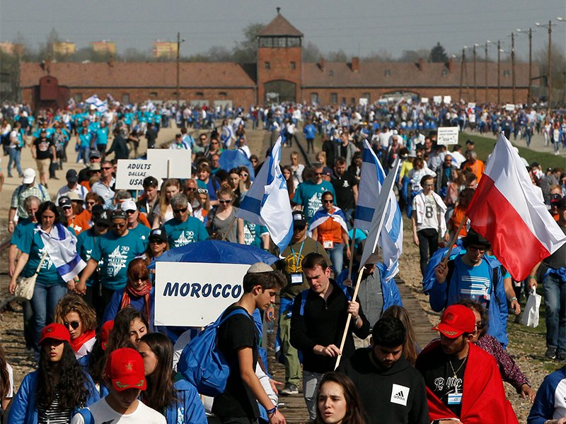 People take part in the annual March of the Living to commemorate the Holocaust, a yearly remembrance march between the former death Nazi camps of Auschwitz and Birkenau, in Oswiecim, Poland, on April 12, 2018. (AP Photo/Czarek Sokolowski)
