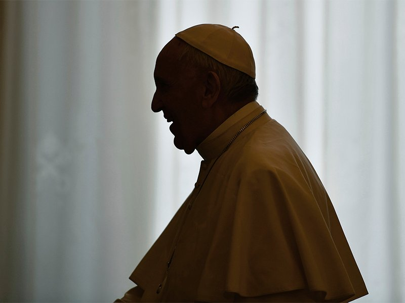 Pope Francis is silhouetted at the end of a private audience with Armenia's President Serzh Sargsyan, at the Vatican, on April 5, 2018. (Alberto Pizzoli/Pool Photo via AP)