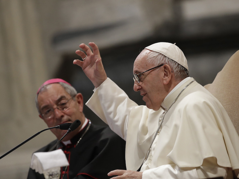 Pope Francis, flanked by Bishop Angelo De Donatis, delivers his speech during a meeting with the Roman diocese, at the Vatican Basilica of St. John at the Lateran, in Rome, Monday, May 14, 2018. (AP Photo/Alessandra Tarantino)
