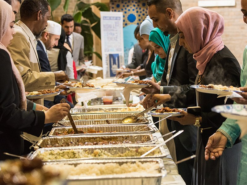 People serve themselves in a buffet line during the U.S. Department of Agriculture (USDA) Interfaith Iftar Celebration in Washington, D.C., on June 22, 2017.   Photo by Lance Cheung/USDA