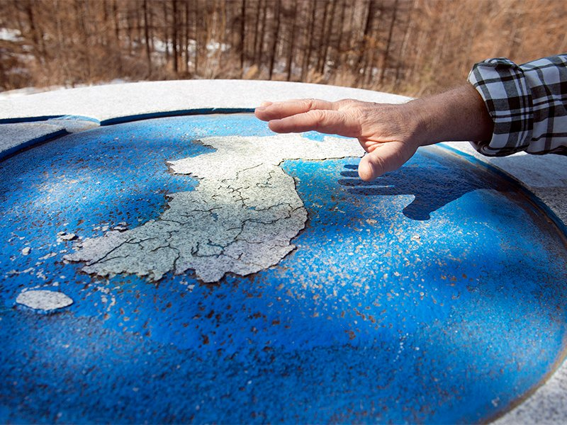 Ben Torrey holds his hand over a map of the Korean peninsula while explaining a shrine at the convergence of Korea's three main watersheds. The American missionary aims to prepare South Korean youth for the peninsula's eventual reunification. RNS photo by Alan Mittelstaedt.
