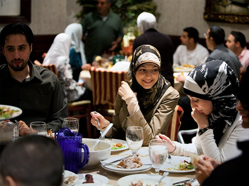A group of diners breaks the fast with iftar at Habib's Cuisine in Dearborn, Mich., in 2011. Photo by Brian Widdis/State Dept./Creative Commons