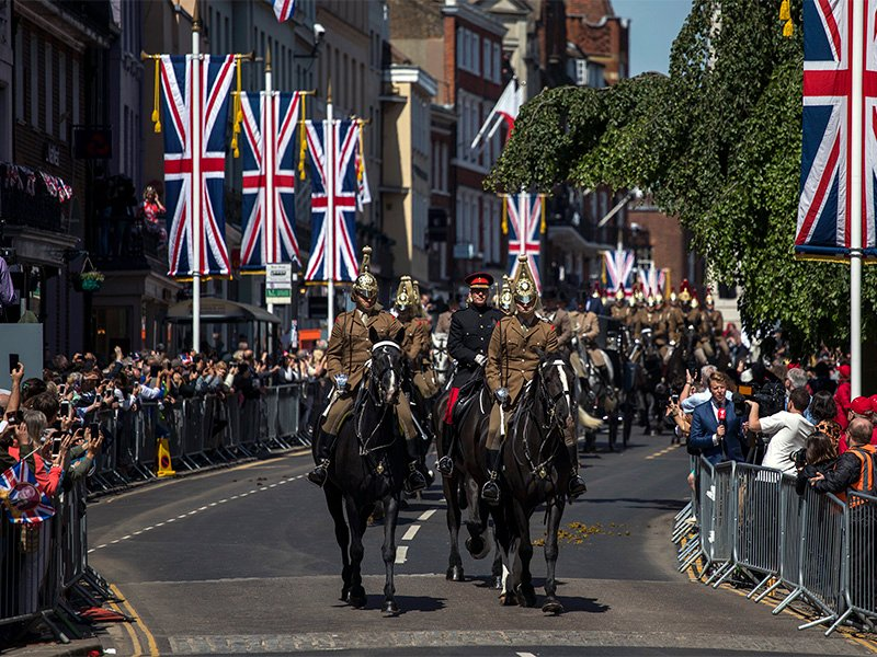 Members of the armed forces ride horses during a parade rehearsal ahead of Prince Harry and Meghan Markle's wedding in Windsor, England, on May 17, 2018. Preparations continue in Windsor ahead of the May 19 royal wedding of Britain's Prince Harry and Meghan Markle. (AP Photo/Emilio Morenatti)