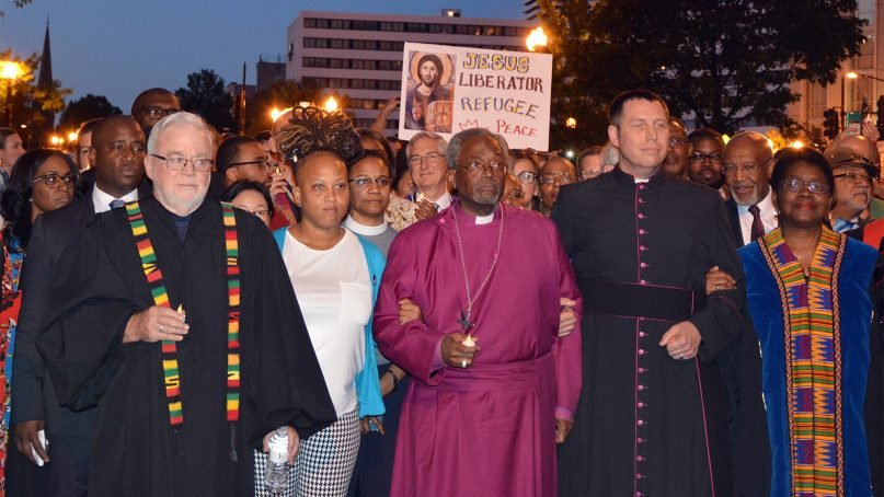 Bishop Michael Curry, center, leads an interfaith march during a Reclaiming Jesus event in Washington on May 24, 2018.  RNS photo by Jack Jenkins