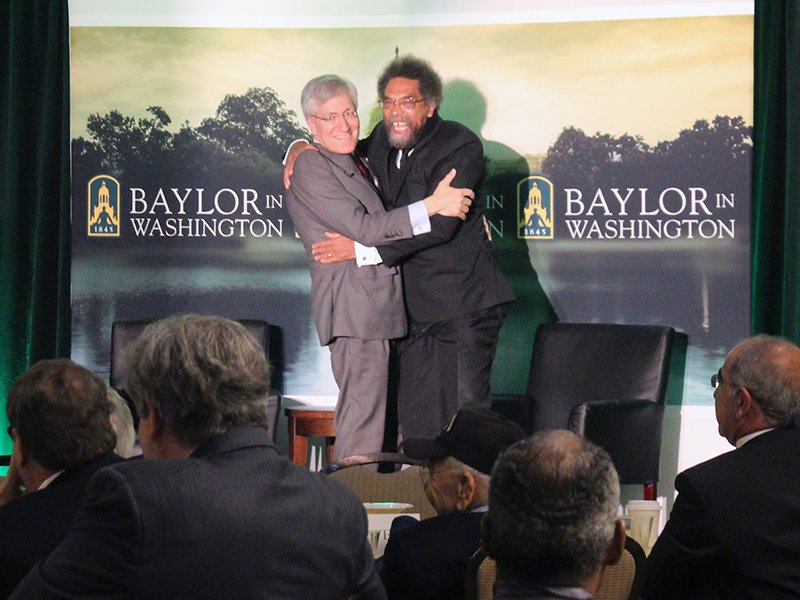 Panelists Robert P. George, left, and Cornel West embrace after a discussion on the life and legacy of the Rev. Martin Luther King Jr. on May 29, 2018. RNS photo by Adelle M. Banks