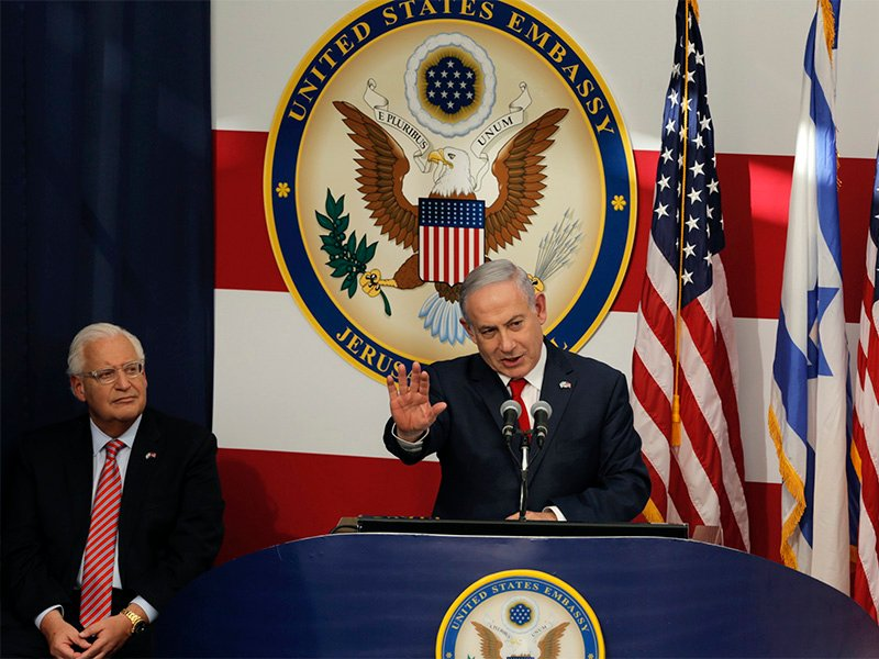 Israeli Prime Minister Benjamin Netanyahu, right, delivers his speech as U.S. Ambassador to Israel David Friedman listens during the opening ceremony of the new U.S. Embassy in Jerusalem on May 14, 2018. Amid deadly clashes along the Israeli-Palestinian border, President Trump's top aides and supporters on Monday celebrated the opening of the new U.S. Embassy in Jerusalem as a campaign promise fulfilled. (AP Photo/Sebastian Scheiner)