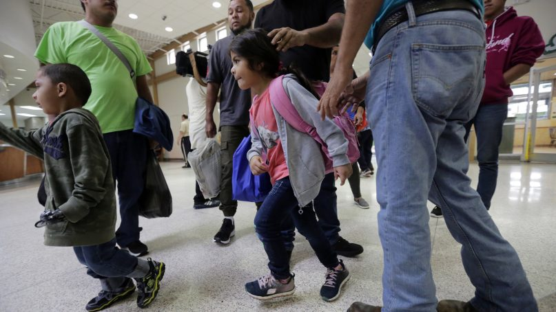 Immigrants from Honduras and Guatemala seeking asylum arrive at the bus station after they were processed and released by U.S. Customs and Border Protection on June 21, 2018, in McAllen, Texas. President Trump signed an executive order to end family separations at the border. (AP Photo/Eric Gay)