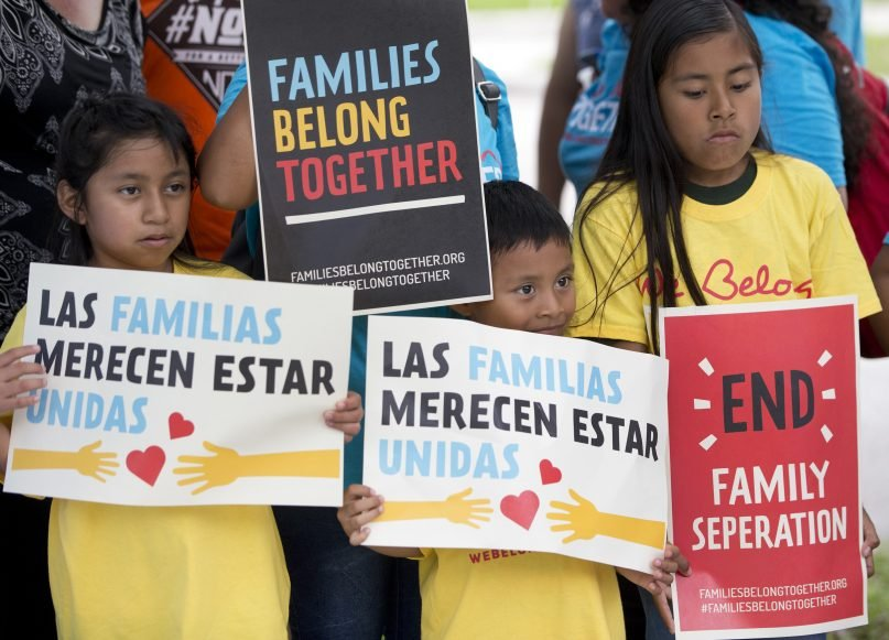 A group of children hold up signs during a demonstration in front of the Immigration and Customs Enforcement (ICE) offices, on June 1, 2018, in Miramar, Fla. The children were taking part in the Families Belong Together Day of Action, where demonstrators in cities across the U.S. protested against separating immigrant children from their families. (AP Photo/Wilfredo Lee)