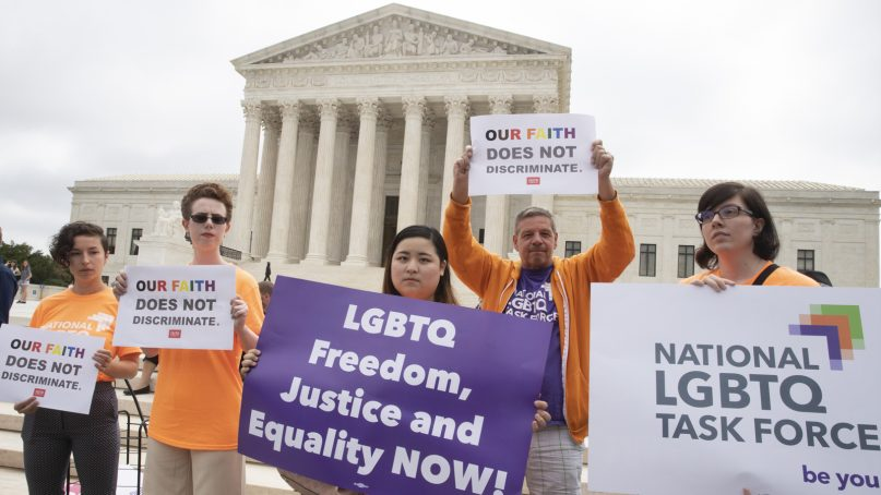 American Civil Liberties Union activists demonstrate in front of the Supreme Court on June 4, 2018, in Washington. (AP Photo/J. Scott Applewhite)