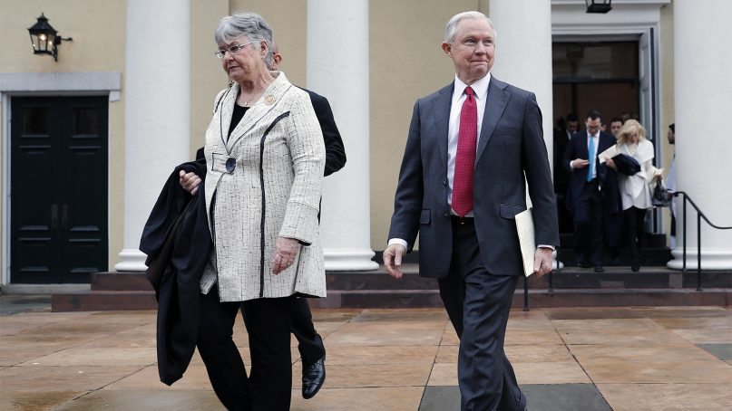 Jeff Sessions and his wife, Mary Sessions, leave a church service at St. John's Episcopal Church across from the White House in Washington, on Jan. 20, 2017. (AP Photo/Pablo Martinez Monsivais)
