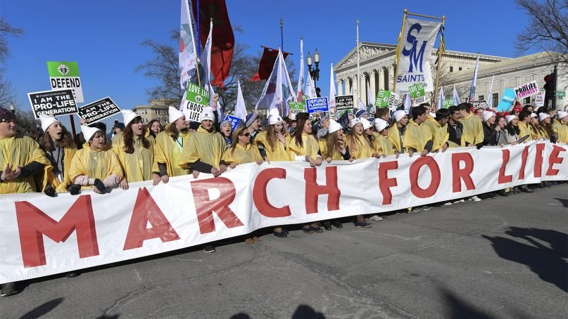 People participate in the March for Life near the Supreme Court in Washington, on Jan. 19, 2018. The march — which typically draws busloads of Catholic school students, a large contingent of evangelical Christians and poster-toting protesters of many persuasions — falls each year around the anniversary of the 1973 Roe v. Wade decision that recognized a legal right to abortion and intends to pressure Congress and the White House to limit legal access to the procedure. (AP Photo/Susan Walsh)