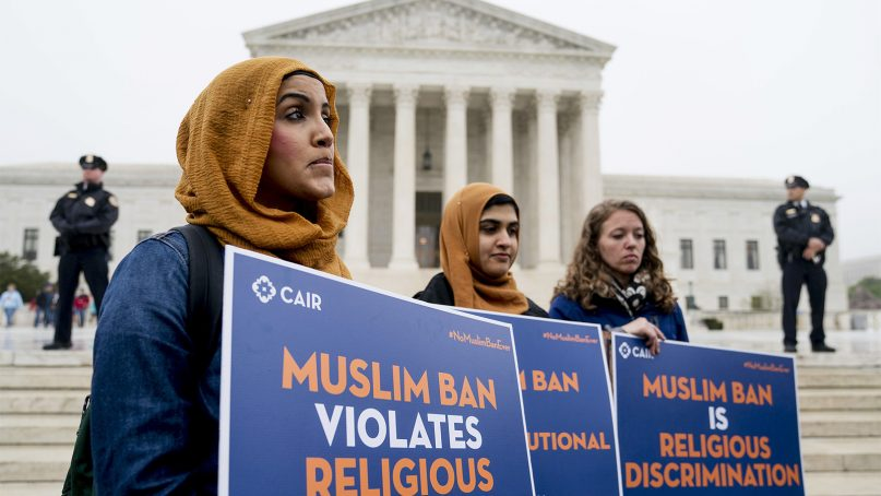 Zainab Chaudry, from left, Zainab Arain and Megan Fair with the Council on American-Islamic Relations stand outside of the Supreme Court for a rally opposing the travel ban as the court hears arguments about President Donald Trump's ban on travelers from several Muslim-majority countries on April 25, 2018, in Washington. (AP Photo/Andrew Harnik)