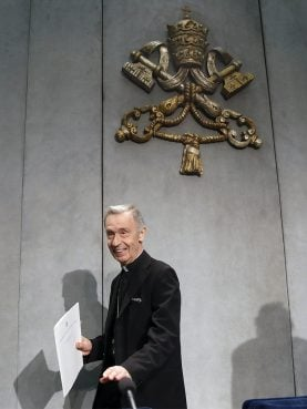 Archbishop Luis Francisco Ladaria Ferrer, Prefect of the Congregation for the Doctrine of the Faith, left, arrives to present a document at the Vatican on May 17, 2018. (AP Photo/Alessandra Tarantino)