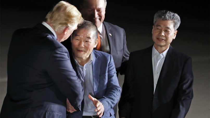 President Donald Trump, left, accompanied by Secretary of State Mike Pompeo, back, shakes hands with former North Korean detainees Kim Dong Chul, and Kim Hak Song, right, upon their arrival at Andrews Air Force Base on May 10, 2018. (AP Photo/Alex Brandon)