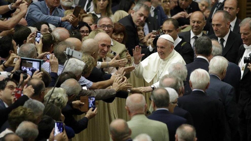 Pope Francis greets people