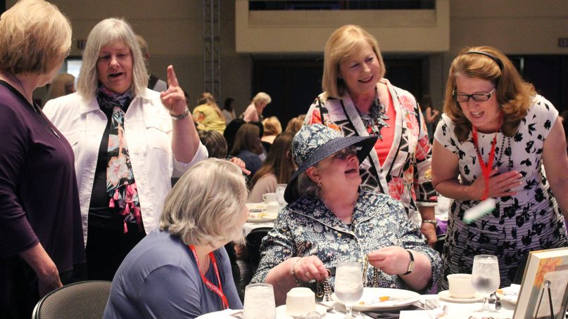 Women greet Dorothy Patterson, seated with hat, before the Tea at 3 women's event hosted by Southwestern Baptist Theological Seminary on June 11, 2018, prior to the Southern Baptist Convention annual meeting in Dallas. RNS photo by Adelle M. Banks