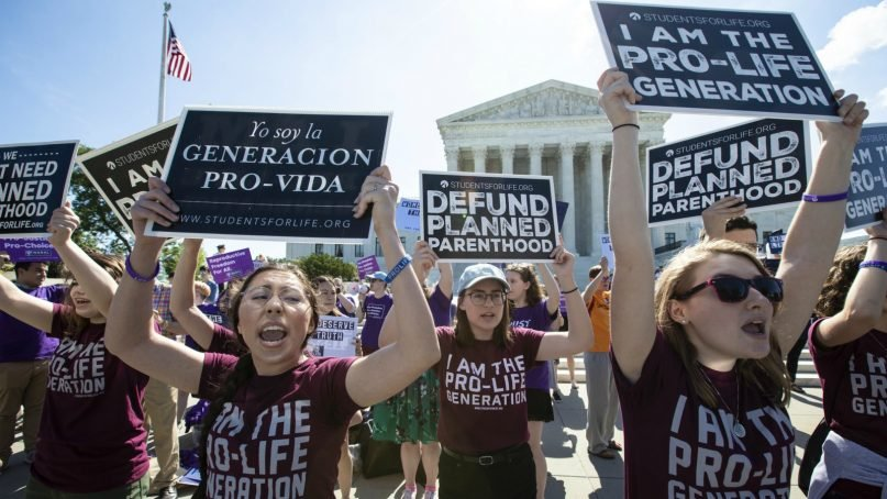 Anti-abortion advocates demonstrate in front of the Supreme Court on June 25, 2018. (AP Photo/J. Scott Applewhite)
