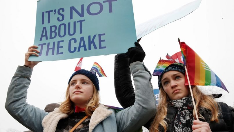Lydia Macy, 17, left, and Mira Gottlieb, 16, both of Berkeley, Calif., rally outside of the Supreme Court on the day of the hearing for the Masterpiece Cakeshop v. Colorado Civil Rights Commission case, on Dec. 5, 2017, in Washington. (AP Photo/Jacquelyn Martin)