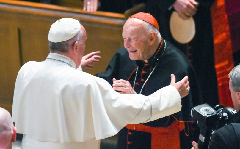 In this Sept. 23, 2015, file photo, Pope Francis reaches out to hug Cardinal Archbishop emeritus Theodore McCarrick after the Midday Prayer of the Divine with more than 300 U.S. bishops at the Cathedral of St. Matthew the Apostle in Washington. (Jonathan Newton /The Washington Post via AP)