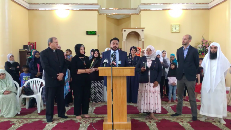 Ahmed Bedier, center, announces the Islamic Society of Tampa Bay's offer to take in all detained migrant children at a news conference June 22, 2018. Photo courtesy of Bedier