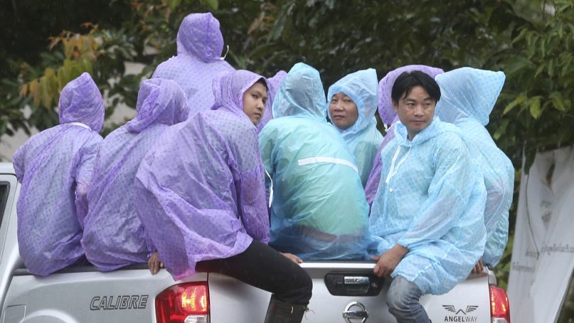 Thai officers prepare to head to an entrance of a cave rescue area to pick up belongings in Mae Sai, Chiang Rai province, northern Thailand, Wednesday, July 11, 2018. A daring rescue mission in the treacherous confines of a flooded cave in northern Thailand has saved all 12 boys and their soccer coach who were trapped deep within the labyrinth, ending a grueling 18-day ordeal that claimed the life of an experienced volunteer diver and riveted people around the world. (AP Photo/Sakchai Lalit)