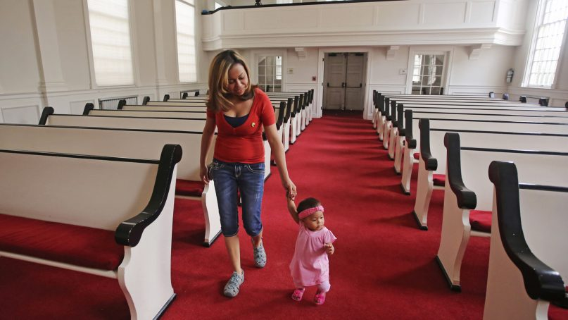 In this May 31, 2018, photo, Vicky Chavez walks with her daughter Issabella in the First Unitarian Church in Salt Lake City. Chavez, a Honduran woman who came to the U.S. four years ago seeking asylum from an abusive boyfriend, says she'll continue taking sanctuary in the church where she's been for the past six months with her two young daughters despite being ordered to leave and exhausting her appeals. (AP Photo/Rick Bowmer)