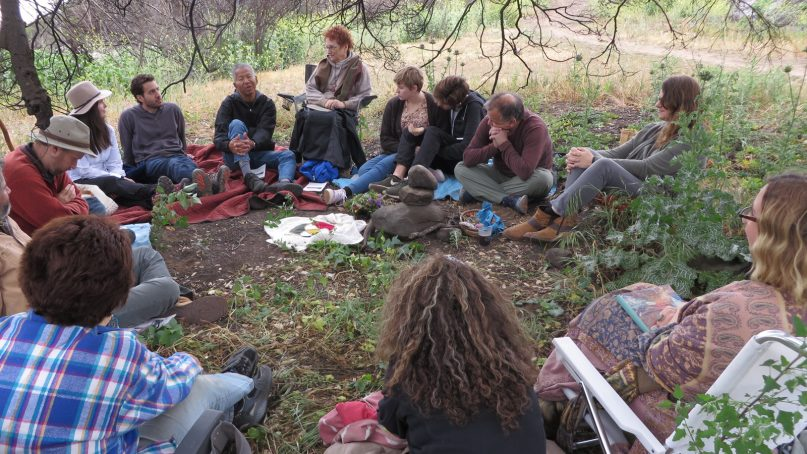 A dozen people gather in a quiet spot in the Ventura River Preserve about 70 miles north of Los Angeles for a Sunday meeting of the Ojai Church of the Wild. Photo by Cathy Lynn Grossman